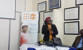 UNFPA Representative Dr Esther Muia speaking at a media briefing to mark World Population Day