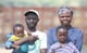 Laina Mutenga, her husband and two of their four children at Forefront Farm